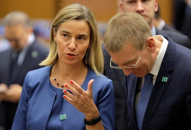 European Union foreign policy chief Federica Mogherini speaks with a delegate before the start of the ''Meeting of the Ministers of the Global Coalition to Counter ISIL: Joint Plenary Session'' at the State Department in Washington, U.S., July 21, 2016. REUTERS/Joshua Roberts