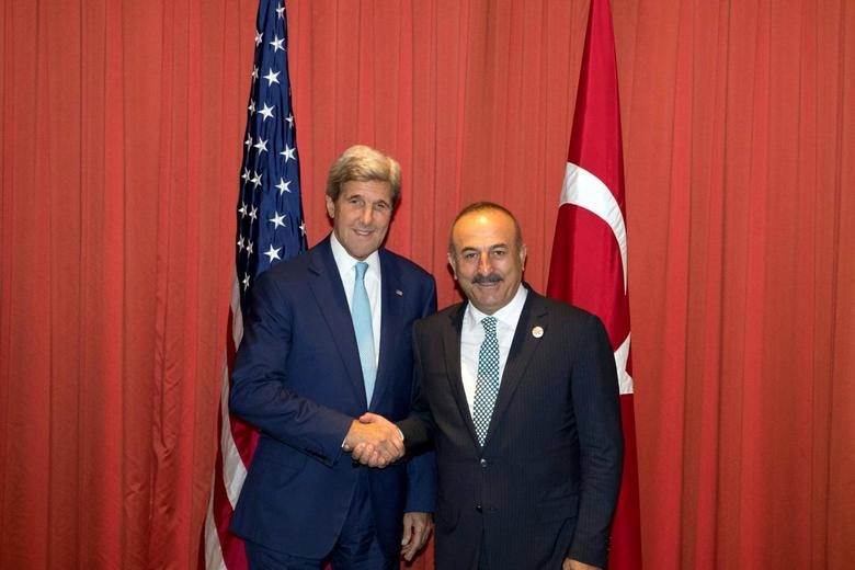 U.S. Secretary of State John Kerry, left and Turkish Foreign Minister Mevlut Cavusoglu at right shake hands before a meeting ahead of the G20 summit in Hangzhou in eastern China's Zhejiang province on Saturday, Sept. 3, 2016. REUTERS/Ng Han Guan/Pool
