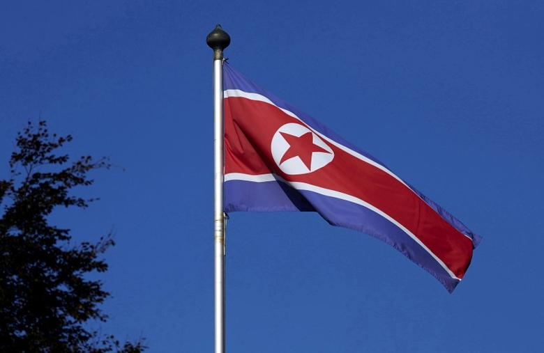 A North Korean flag flies on a mast at the Permanent Mission of North Korea in Geneva October 2, 2014. REUTERS/Denis Balibouse/File Photo - RTX2OQMV