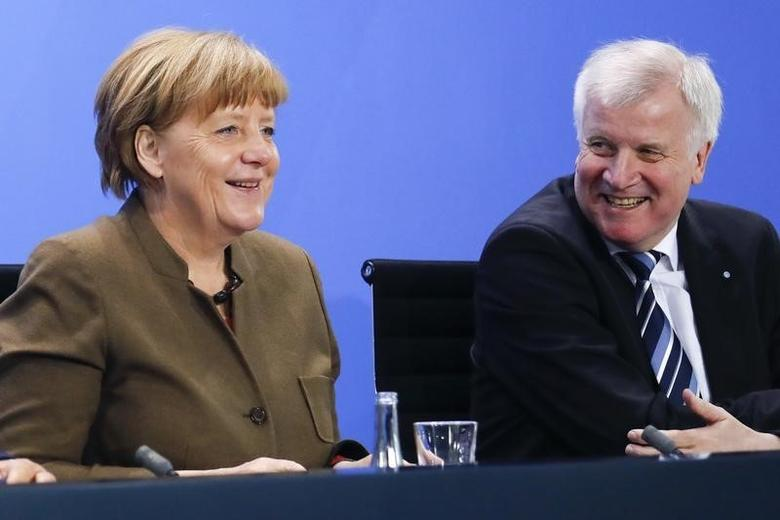 German Chancellor Angela Merkel smiles next Bavarian state premier and leader of the Christian Social Union (CSU) Horst Seehofer (R) during a news conference at the Chancellery in Berlin, Germany, April 14, 2016.   REUTERS/Fabrizio Bensch