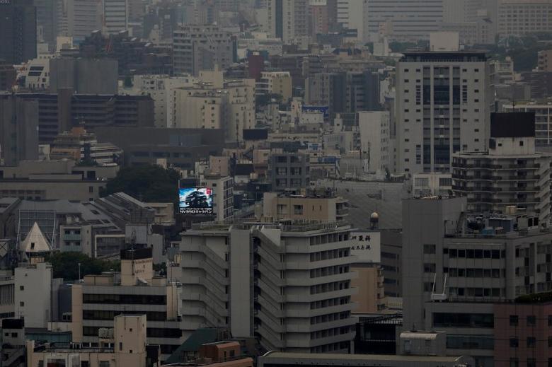 A billboard advertising a car is seen in central Tokyo, Japan June 7, 2016.  REUTERS/Toru Hanai