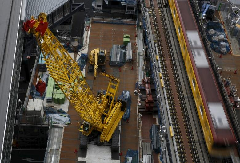 Heavy machineries are seen next to a subway train at a construction site in Tokyo, Japan, March 13, 2016.  REUTERS/Yuya Shino