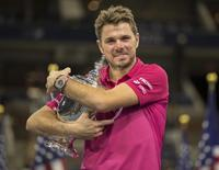Sep 11, 2016; New York, NY, USA; Stan Wawrinka (SUI) poses with the trophy after his match against Novak Djokovic (SRB) on day fourteen of the 2016 U.S. Open tennis tournament at USTA Billie Jean King National Tennis Center. Mandatory Credit: Susan Mullane-USA TODAY Sports