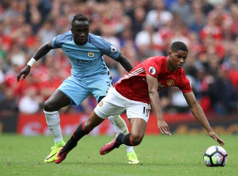 Britain Soccer Football - Manchester United v Manchester City - Premier League - Old Trafford - 10/9/16. Manchester United's Marcus Rashford in action with Manchester City's Bacary Sagna. Reuters / Phil Noble. Livepic