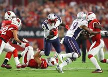 Sep 11, 2016; Glendale, AZ, USA; New England Patriots running back LeGarrette Blount (29) runs the ball against the Arizona Cardinals in the second quarter at University of Phoenix Stadium. Mandatory Credit: Mark J. Rebilas-USA TODAY Sports
