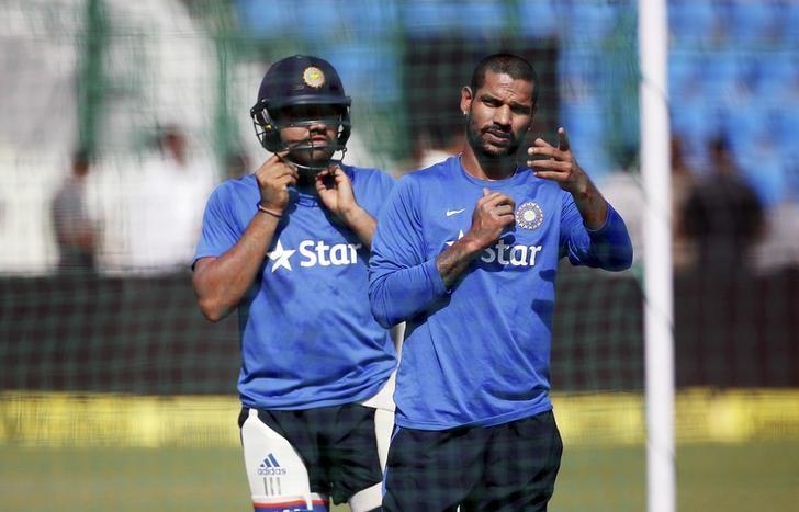 India's Shikhar Dhawan and Rohit Sharma (R) prepare to bat during a practice session ahead of their first one-day international cricket match against South Africa in Kanpur, India, October 10, 2015. REUTERS/Adnan Abidi/File Photo