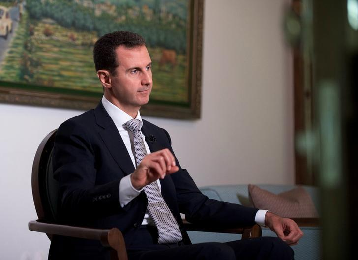 Syria's President Bashar al-Assad speaks during an interview with a Cuban news agency in this handout picture provided by SANA on July 21, 2016. SANA/Handout via REUTERS/Files