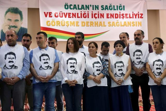 Pro-Kurdish politicians wearing t-shirts featuring Abdullah Ocalan gather to start a hunger strike to demand the right to visit the jailed PKK militant leader Ocalan, in Diyarbakir, Turkey, September 5, 2016. REUTERS/Sertac Kayar