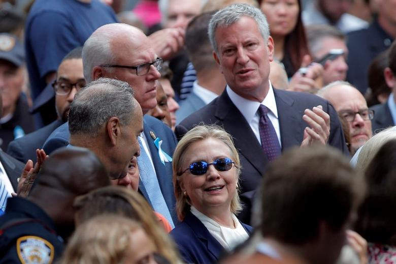 U.S. Democratic presidential candidate Hillary Clinton and New York Mayor Bill de Blasio (R) attend ceremonies to mark the 15th anniversary of the September 11 attacks at the National 9/11 Memorial in New York, New York, United States September 11, 2016.  REUTERS/Brian Snyder