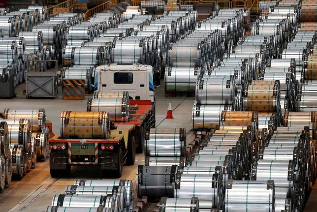 A truck drives past rolls of steel inside the China Steel Corporation factory, in Kaohsiung, southern Taiwan August 26, 2016. REUTERS/Tyrone Siu