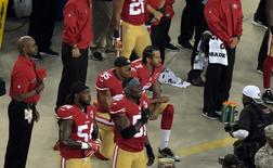 Sep 12, 2016; Santa Clara, CA, USA; San Francisco 49ers quarterback Colin Kaepernick (7) and free safety Eric Reid (35) kneel during the playing of the national anthem before a NFL game against the Los Angeles Rams at Levi's Stadium. Mandatory Credit: Kirby Lee-USA TODAY Sports