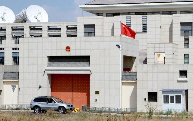 A car is parked near China's embassy in Bishkek, Kyrgyzstan, August 30, 2016. REUTERS/Vladimir Pirogov