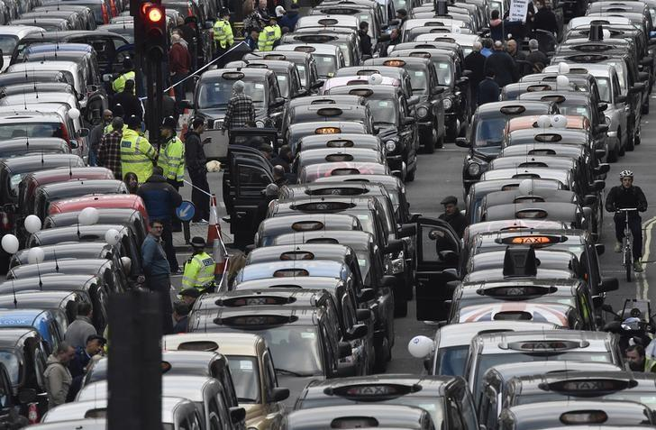 London cab drivers protest against Uber in central London, Britain February 10, 2016. REUTERS/Toby Melville/File Photo