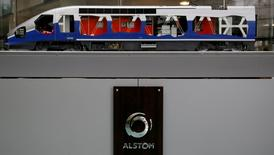 A scale model high speed train and the logo of the Alstom are seen before the the news conference to present the company's full year to end-March 2015/16 annual results in Saint-Ouen, near Paris, France, May 11, 2016. REUTERS/Gonzalo Fuentes/File Photo