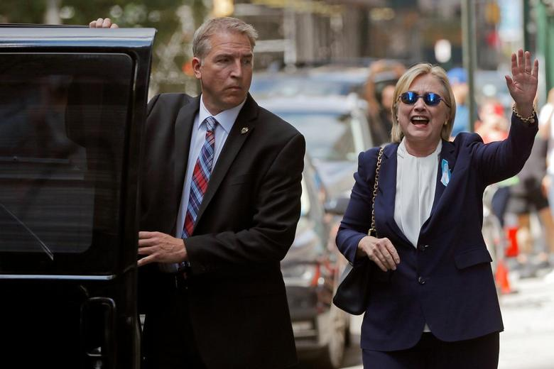 U.S. Democratic presidential candidate Hillary Clinton leaves her daughter Chelsea's home in New York, New York, United States September 11, 2016, after Clinton left ceremonies commemorating the 15th anniversary of the September 11 attacks feeling ''overheated.''  REUTERS/Brian Snyder/File Photo