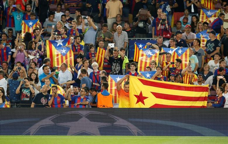 Football Soccer - FC Barcelona v Celtic - UEFA Champions League Group Stage - Group C - The Nou Camp, Barcelona, Spain - 13/9/16Barcelona fans with 'Estelada' flags Reuters / Albert GeaLivepic