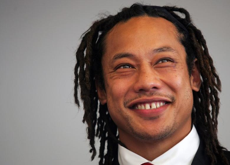 File Picture - Former New Zealand All Blacks team captain Tana Umaga smiles during a welcoming ceremony in Toulon October 28, 2006.  REUTERS/Jean-Paul Pelissier