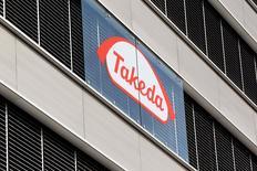 Takeda Pharmaceutical, le premier groupe pharmaceutique japonais, est prêt à consacrer jusqu'à 15 milliards de dollars (13,4 milliards d'euros) à de possibles acquisitions lui permettant de développer ses activités aux Etats-Unis. Cette somme sera utilisée soit pour une grosse opération de rachat soit pour une série de transactions plus modestes. /Photo d'archives/REUTERS/Arnd Wiegmann