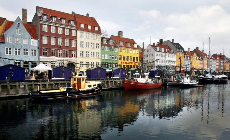 Boats are seen anchored at the 17th century Nyhavn district, home to many shops and restaurants in Copenhagen, Denmark, December 5, 2009. REUTERS/Bob Strong/File Photo