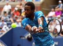 Gael Monfils of France playing Novak Djokovic of Serbia on day twelve of the 2016 U.S. Open tennis tournament at USTA Billie Jean King National Tennis Center. Mandatory Credit: Robert Deutsch-USA TODAY Sports