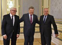 Foreign Ministers Frank-Walter Steinmeier of Germany (L), Jean-Marc Ayrault of France (R) and Ukrainian President Petro Poroshenko attend a meeting in Kiev, Ukraine, September 14, 2016. REUTERS/Genya Savilov/Pool