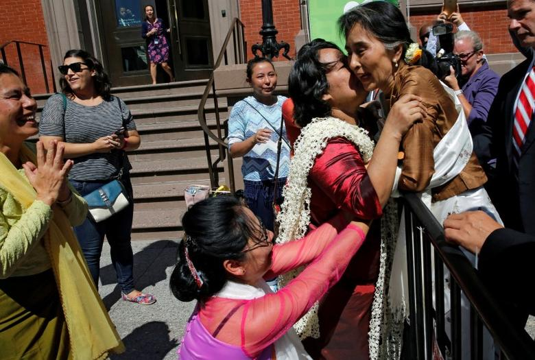 Supporters rush to greet and kiss Myanmar's State Counsellor Aung San Suu Kyi as she comes over to a security barrier where they were waiting for her outside of her lunch meeting with U.S. Secretary of State John Kerry in Washington, D.C., U.S. September 14, 2016. REUTERS/Jonathan Ernst