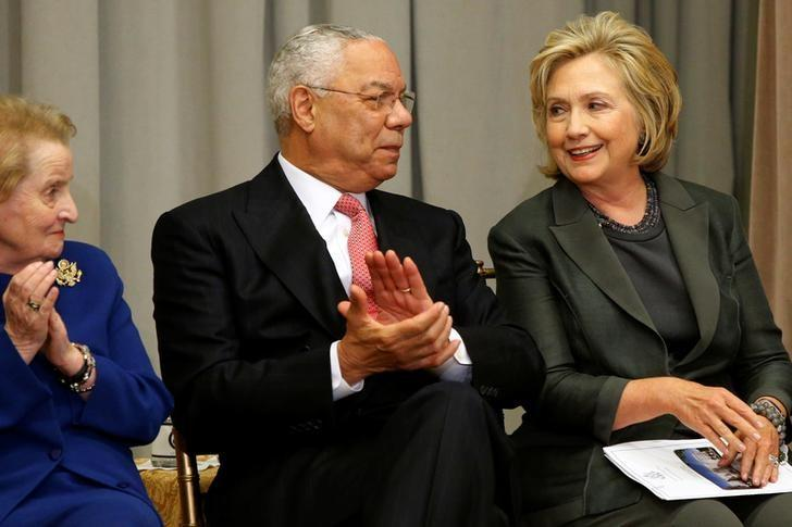 Former U.S. Secretaries of State Madeleine Albright (L-R), Colin Powell and Hillary Clinton listen to remarks at a groundbreaking ceremony for the U.S. Diplomacy Center at the State Department in Washington September 3, 2014.  REUTERS/Jonathan Ernst/File Photo