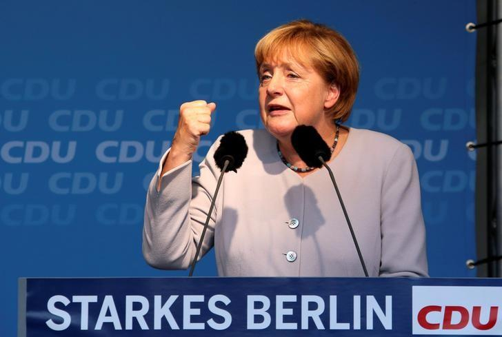 German Chancellor and chairwoman of the Christian Democratic Union (CDU) Angela Merkel addresses supporters during an election campaign rally for local city elections in Berlin, Germany, September 14, 2016. The words read ''Strong Berlin''. REUTERS/Fabrizio Bensch