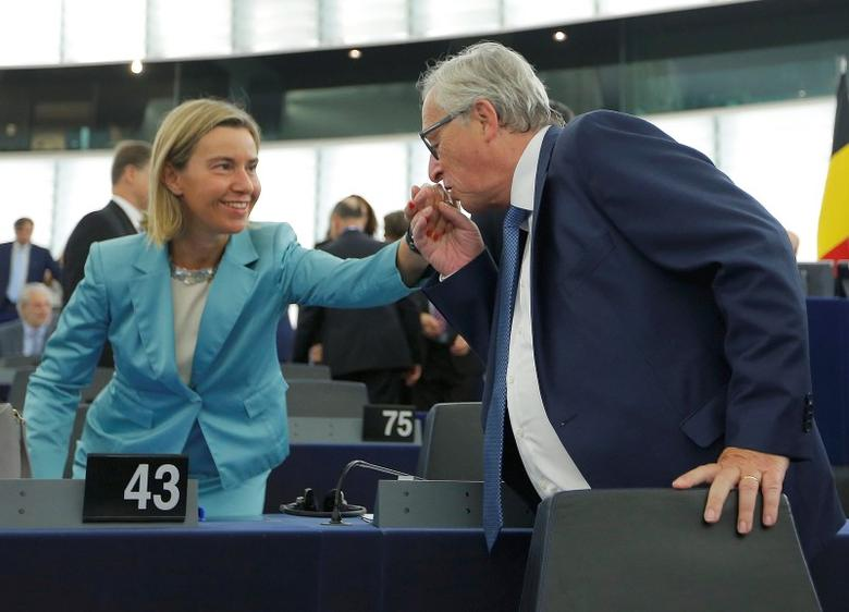 European Commission President Jean-Claude Juncker (R) greets European Union foreign policy chief Federica Mogherini ahead of a debate on The State of the European Union at the European Parliament in Strasbourg, France, September 14, 2016.   REUTERS/Vincent Kessler