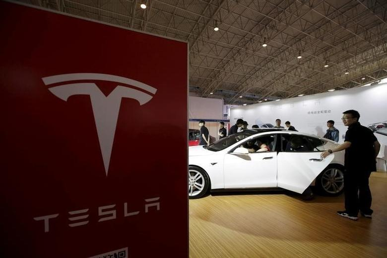 People visit a Tesla Model S car during the Auto China 2016 in Beijing, China, April 25, 2016. REUTERS/Jason Lee/File Photo