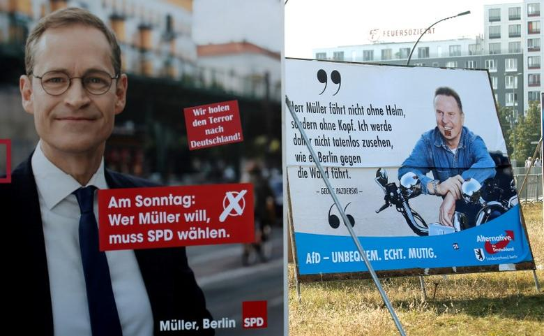 Election posters of top candidate of Social Democratic Party (SPD) and Mayor of Berlin Michael Mueller (L) and top candidate of the anti-immigration party Alternative for Germany (AfD) Georg Pazderski for the upcomming local city elections are pictured in Berlin, Germany, September 14, 2016.    REUTERS/Fabrizio Bensch