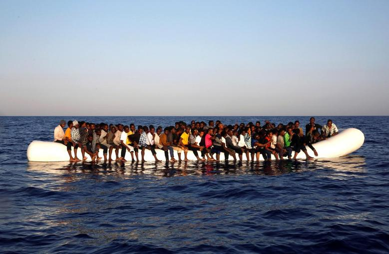 A dinghy overcrowded by African migrants is seen drifting off the Libyan coast in Mediterranean Sea August 20, 2016.  REUTERS/Giorgos Moutafis