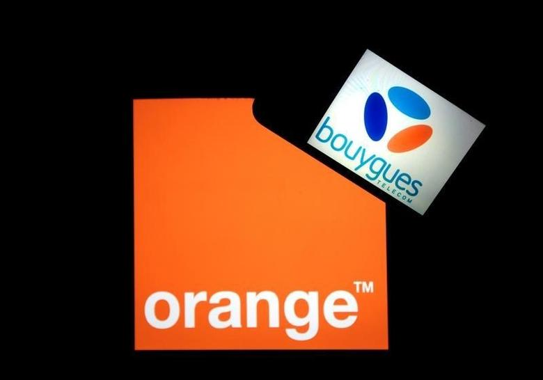 Company logos for French telecom operator Orange, on a tablet screen, and Bouygues Telecom, on a mobile phone screen, are seen in this illustration photo taken in Nice, France, April 1, 2016.  REUTERS/Eric Gaillard/Illustration/File Photo