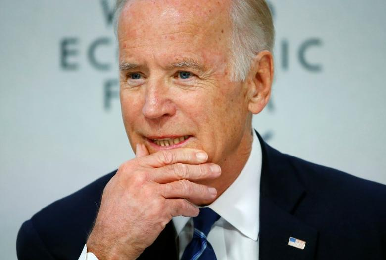 U.S. Vice President Joe Biden addresses the session ''Cancer Moonshot: A Call to Action'' during the annual meeting of the World Economic Forum (WEF) in Davos, Switzerland in this file photo dated January 19, 2016. REUTERS/Ruben Sprich