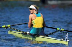 2016 Rio Olympics - Rowing - Final - Women's Single Sculls Final A - Lagoa Stadium - Rio De Janeiro, Brazil - 13/08/2016. Gold medalist Kim Brennan (AUS) of Australia looks on after the finish. REUTERS/Murad Sezer