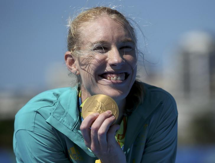 2016 Rio Olympics - Rowing - Final - Women's Single Sculls Victory Ceremony - Lagoa Stadium - Rio De Janeiro, Brazil - 13/08/2016. Kim Brennan (AUS) of Australia poses with her gold medal. REUTERS/Carlos Barria