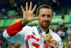 2016 Rio Olympics - Cycling Track - Victory Ceremony - Men's Team Pursuit Victory Ceremony - Rio Olympic Velodrome - Rio de Janeiro, Brazil - 12/08/2016. Bradley Wiggins (GBR) of Britain poses with his gold medal. REUTERSEric Gaillard
