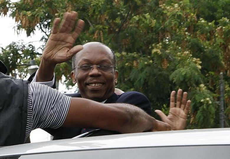 Former Haitian President Jean-Bertrand Aristide waves to supporters as he arrives outside a court in Port-au-Prince, May 8, 2013.  REUTERS/Marie Arago