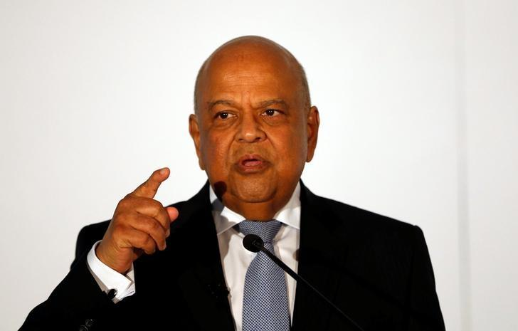 Finance Minister Pravin Gordhan gestures during his address at a business summit in Sandton, South Africa, September 13, 2016. REUTERS/Siphiwe Sibeko/Files
