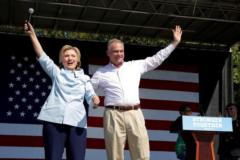 U.S. Democratic presidential candidate Hillary Clinton is joined by her running mate, vice-presidential candidate and U.S. Senator Tim Kaine, during a campaign stop at the 11th Congressional District Labor Day Parade and Festival in Cleveland, Ohio, United States September 5, 2016.  REUTERS/Brian Snyder