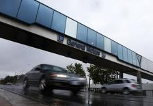 Cars pass under an overpass at the General Motors Car assembly plant in Oshawa, June 1, 2012. REUTERS/Mark Blinch/File Photo