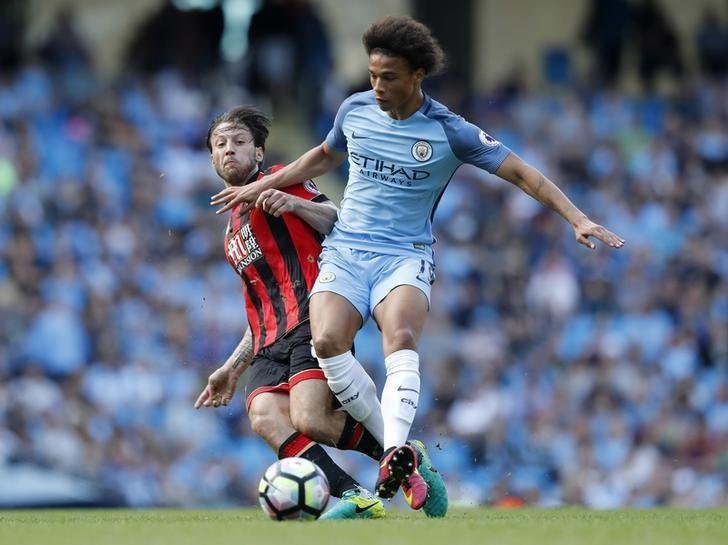Football Soccer Britain - Manchester City v AFC Bournemouth - Premier League - Etihad Stadium - 17/9/16Manchester City's Leroy Sane in action with Bournemouth's Harry Arter Action Images via Reuters / Carl RecineLivepic