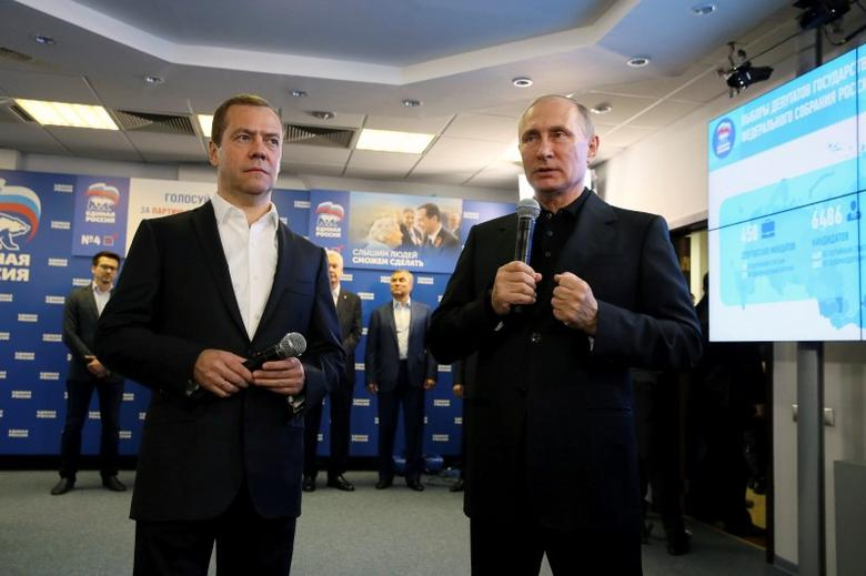 Russian President Vladimir Putin, Prime Minister and Chairman of the United Russia party Dmitry Medvedev visit the party's campaign headquarters following a parliamentary election in Moscow, Russia, September 18, 2016. Sputnik/Pool/Ekaterina Shtukina via REUTERS