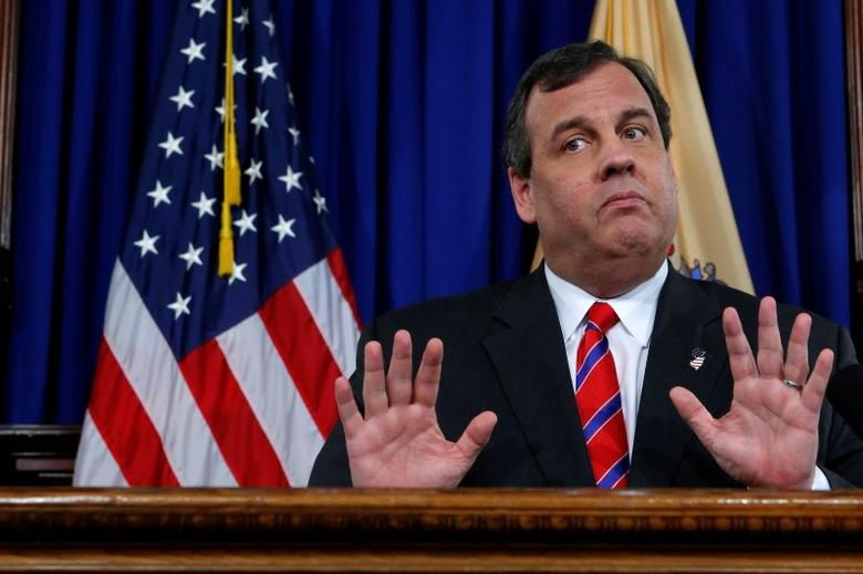 New Jersey Governor Chris Christie reacts to a question during a news conference in Trenton, New Jersey, U.S. on March 28, 2014. REUTERS/Eduardo Munoz/File Photo