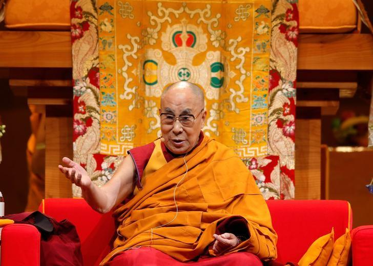 Tibet's exiled spiritual leader the Dalai Lama gestures as he gives a public religious lecture to the faithful in Strasbourg, France, September 17, 2016. REUTERS/Vincent Kessler