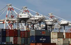 Shipping containers and cranes are seen at a port holding yard in Melbourne in this June 2, 2010 file photo.   REUTERS/Mick Tsikas/Files