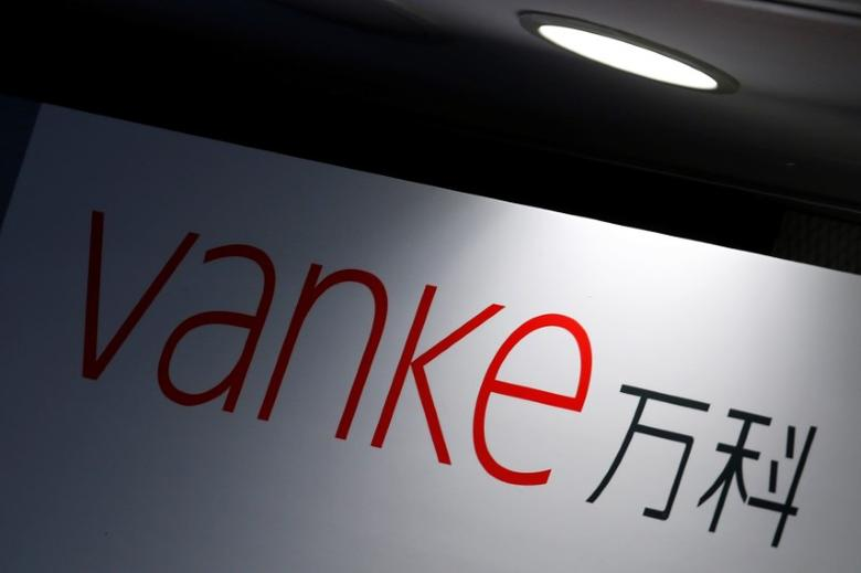 The company logo of China Vanke is displayed at a news conference announcing the property developer's interim results in Hong Kong, China August 22, 2016.  REUTERS/Bobby Yip