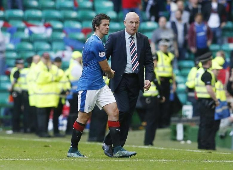 Britain Soccer Football - Celtic v Rangers - Scottish Premiership - Celtic Park - 10/9/16Rangers manager Mark Warburton with' Joey Barton at the end of the gameReuters / Russell CheyneLivepicEDITORIAL USE ONLY.