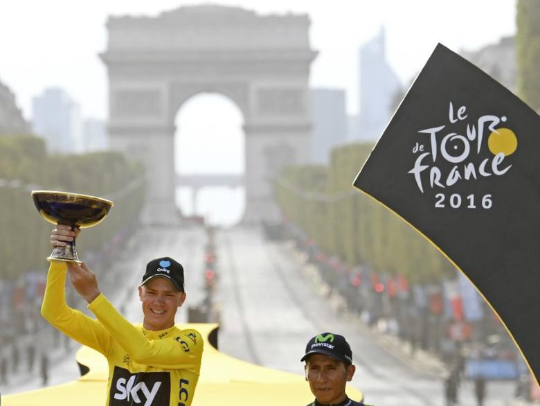 Cycling - Tour de France cycling race - The 113-km (70,4 miles) Stage 21 from Chantilly to Paris, France - 24/07/2016  - Yellow jersey leader and overall winner Team Sky rider Chris Froome of Britain reacts on the podium.  REUTERS/Stephane Mantey/Pool