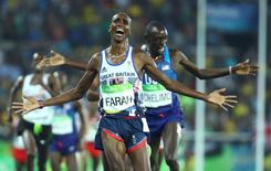 2016 Rio Olympics - Athletics - Final - Men's 5000m Final - Olympic Stadium - Rio de Janeiro, Brazil - 20/08/2016. Mo Farah (GBR) of Britain celebrates winning the gold. REUTERS/Lucy Nicholson